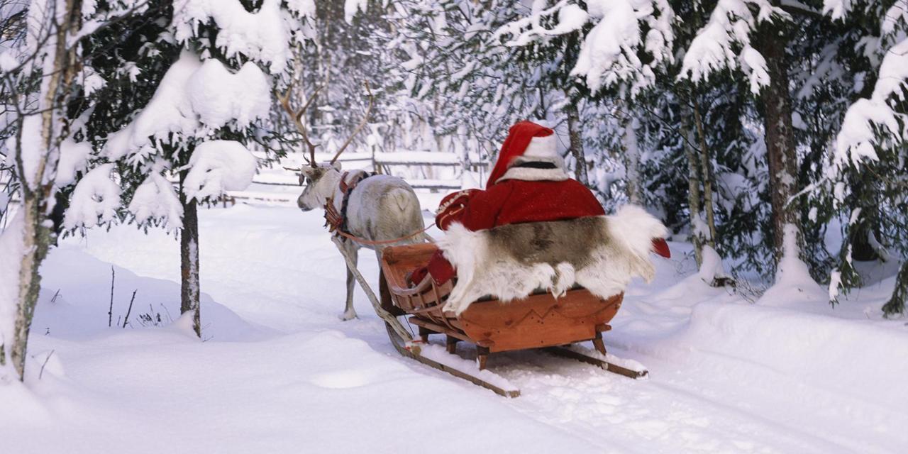 Ảnh ông già noel cưỡi tuần lộc trên tuyết