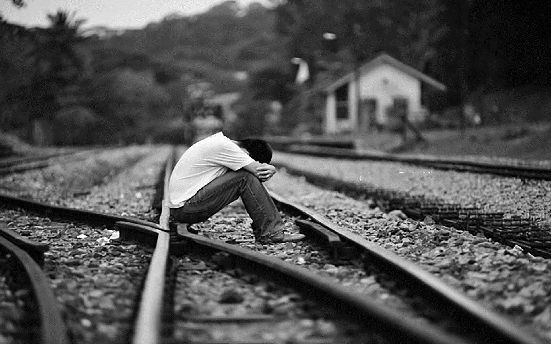 Hình nền con trai buồn